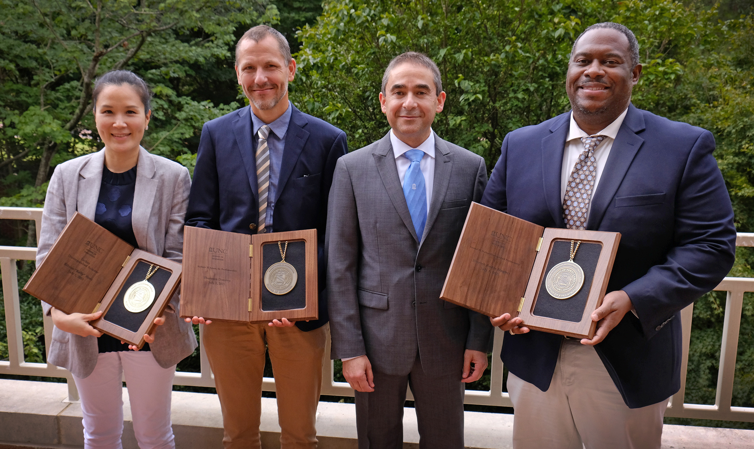 Group of five, with four holding professorship medallions
